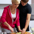 Lovely couple making a salad — Stock Photo