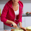 Young lady making salad in kitchen — Foto Stock
