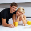 Royalty-Free Stock Photo: Happy couple posing in the kitchen with cups and lemons