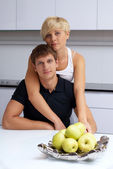 Happy couple posing in the kitchen — Stock Photo