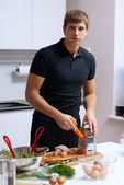 Young man making his breakfast — Stock Photo