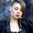 Blond hipster girl with leopard haircut smoking cigarette alone — Stock fotografie