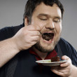 Funny fat guy eating chocolate cake — Stock Photo #8175831