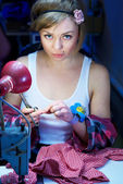 Seductive blond sewing in her workshop — Stock Photo