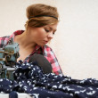 Woman seamstress posing near sewing machine — Stock Photo