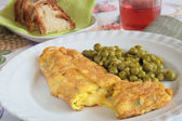 Cheese omelette with green peas, bread and wine — Stock Photo