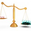 More good than evil in the gold scales — Stock Photo