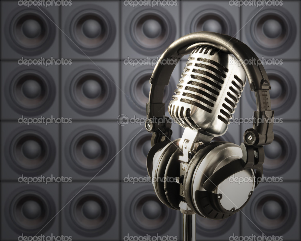 ''Retro'' Microphone & DJ Headphones In Spotlight Against The Wall Of Speakers  Stock Photo #9783229