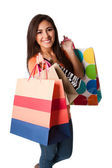 Happy young woman on shopping spree — Stock Photo