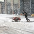 Постер, плакат: Man shoveling snow during snow storm