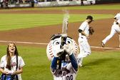 Mr. Mets shooting T-Shirt gun — Stock Photo