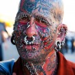 Stock Photo: Face with tattoos and piercings