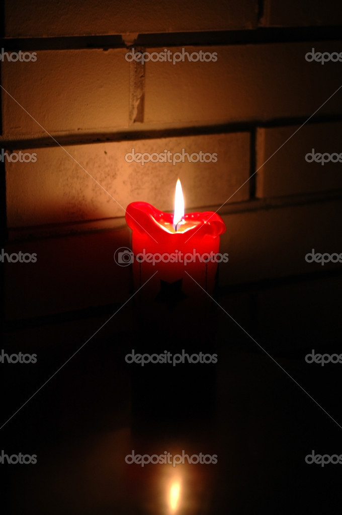A red candle in the dark with wall background — Stock Photo #9732595