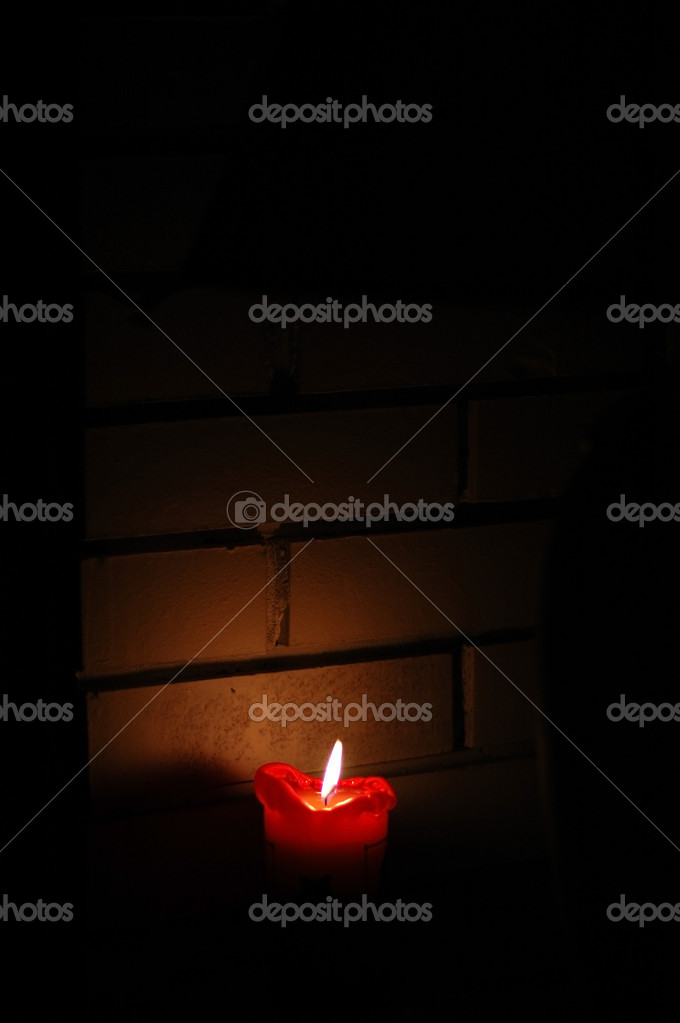 A red candle in the dark with wall background — Stock Photo #9732663