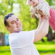 Dad throws daughter — Stock Photo