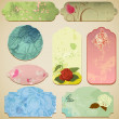 Vintage paper tags with floral decorations — Stock Vector