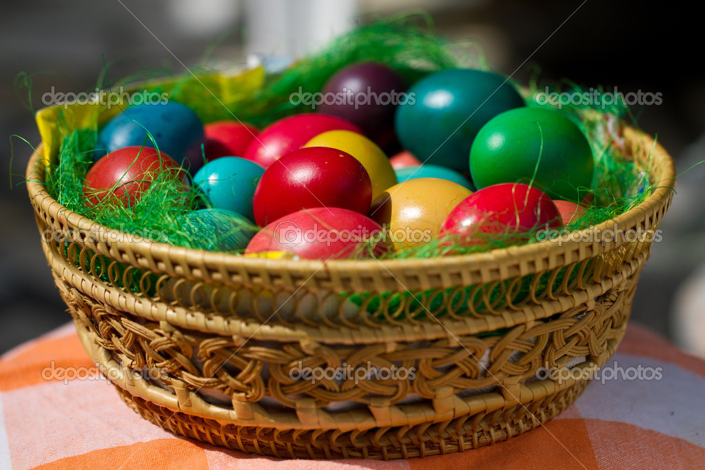 Colored easter eggs in wooden plate  Stock Photo #10098732