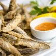Fried sprat with souce — Stock Photo