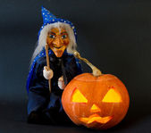 Helloween pumpkin with scary riding hag — Stock Photo