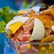 Slad with eggs, ham and green lettuce — Stock Photo #9991946