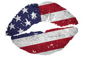 Kissing the american flag — Stock Photo