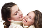 Beautiful little girl and her mother — Stock Photo