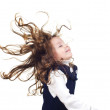 Little girl with flying hair — Stock Photo