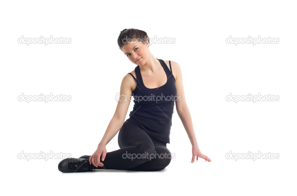 Beautiful young caucasian brunette woman wearing sportswear sitting on the white floor. Isolated against white background — Stock Photo #9374406