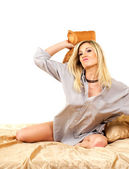 Blonde woman on bed — Stok fotoğraf