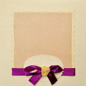 Photo album book cover decorated with purple bow — Stock Photo