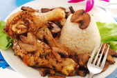 Chicken legs with mushrooms and rice — Stock Photo
