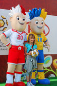 Young girl with euro 2012 talismans — Foto Stock
