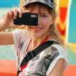 Young girl taking photo with mobile phone — Stock Photo #10522626