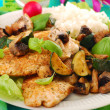 Stock Photo: Grilled chicken breast with zucchini and mushrooms