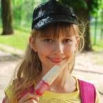 Young girl eating ice cream — Stock Photo #10550365