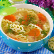 Chicken soup with noodle for child — Stock Photo #10550425