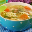 Chicken soup with noodle for child — Stock Photo #10550461