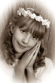 Girl going to the first holy communion (sepia) — Stock fotografie