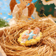 Nativity scene with baby jesus and angel — Stock Photo