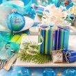 Foto Stock: Christmas table with gift box decoration on plate