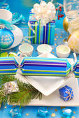 Festive table with christmas cracker decoration — Stock Photo