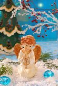 Angel kneeling on the snow and praying — Stock Photo