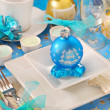 Christmas table with blue bauble decoration on the plate — Stock Photo