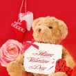 Valentine`s greetings from teddy bear - Stock Photo