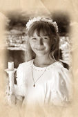 Girl going to the first holy communion in sepia — Stock Photo