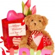 Teddy bear with valentine`s gifts — Stock Photo #8949275