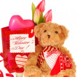 Teddy bear with valentine`s gifts — Stock Photo #8949279