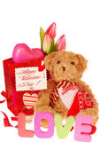 Teddy bear with valentine`s gifts — Stock Photo