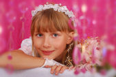 Girl going to the first holy communion (in studio) — Stock fotografie
