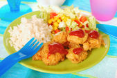 Dinner for child with chicken nuggets — Stock Photo